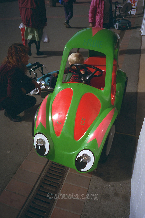 Child in a VW beetle car ride, Brighton Mall, New Brighton, Christchurch.