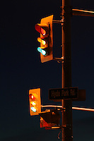 Traffic Signal Lights Against Inky Clear Dusk Sky with All Signals Illuminated