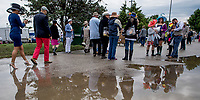 LOUISVILLE, KY - MAY 06: Fans walk through the puddles on Kentucky Derby Day at Churchill Downs on May 6, 2017 in Louisville, Kentucky. (Photo by Scott Serio/Eclipse Sportswire/Getty Images)