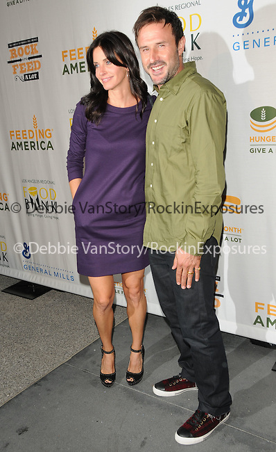 David Arquette & Courteney Cox at The Rock a Little ,Feed a lot benefit concert to support the L.A. Regional Food Bank & Feeding America held at Club Nokia in Los Angeles, California on September 29,2009                                                                   Copyright 2009 Debbie VanStory / RockinExposures