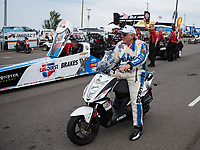 Jul 20, 2018; Morrison, CO, USA; NHRA funny car driver John Force sits alongside the dragster of daughter Brittany Force during qualifying for the Mile High Nationals at Bandimere Speedway. Mandatory Credit: Mark J. Rebilas-USA TODAY Sports