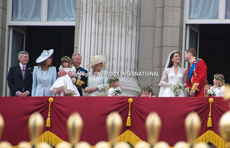 """PRINCE WILLIAM AND CATHERINE MIDDLETON .make an appearance on the balcony of Buckingham Palace, London_29/04/2011.Mandatory Photo Credit: ©Shaw/Newspix International..**ALL FEES PAYABLE  TO: """"NEWSPIX INTERNATIONAL""""**..PHOTO CREDIT MANDATORY!!: NEWSPIX INTERNATIONAL(Failure to credit will incur a surcharge of 100% of reproduction fees)..IMMEDIATE CONFIRMATION OF USAGE REQUIRED:.Newspix International, 31 Chinnery Hill, Bishop's Stortford, ENGLAND CM23 3PS.Tel:+441279 324672  ; Fax: +441279656877.Mobile:  0777568 1153.e-mail: info@newspixinternational.co.uk"""