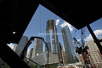 Tenth anniversary of 9/11.  Rebuilding at the World Trade Center site.  The view from under construction 4 WTC, L to R: World Financial Center buildings, under-construction 1 WTC, 7 WTC, and postal building.   9/11 Memorial building is in foreground.  Photo by Ari Mintz.  8/11/2011.