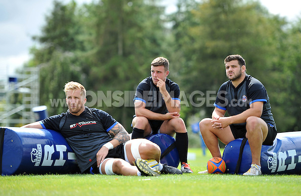 Dom Day, George Ford and Rob Webber watch visiting rugby league side Wigan Warriors train. Bath Rugby pre-season training session on August 18, 2014 at Farleigh House in Bath, England. Photo by: Patrick Khachfe/Onside Images