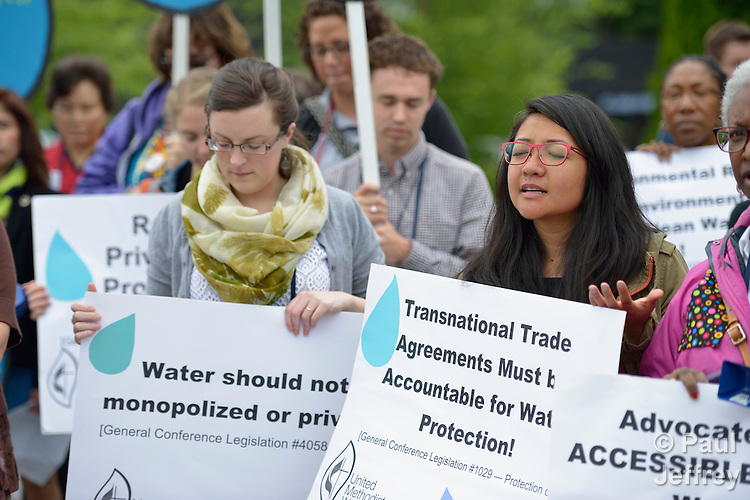Participants pray during a May 16 vigil for environmental justice at the 2016 United Methodist General Conference in Portland, Ore. Sponsored by United Methodist Women, the vigil focused especially on struggles for clean water around the world. Photo by Paul Jeffrey.