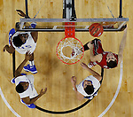 SIOUX FALLS, SD - MARCH 5:  Players from South Dakota and Fort Wayne fight for a rebound in the 2016 Summit League Tournament. (Photo by Dick Carlson/Inertia)