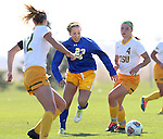 BROOKINGS, SD - OCTOBER 18: Annie Williams #23 from South Dakota State splits the defense of Meghan Johnston #12 and Roxy Roemer #4 from North Dakota State during their game Sunday afternoon at Fischback Soccer Field in Brookings. (Photo by Dave Eggen/Inertia)