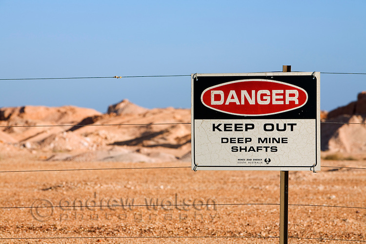 A danger sign warning of deep mine shafts in the Coober Pedy opal fields.  Cober Pedy, South Australia, AUSTRALIA.