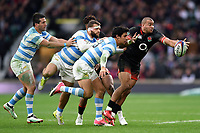 Jonathan Joseph of England looks to offload the ball after being tackled. Old Mutual Wealth Series International match between England and Argentina on November 11, 2017 at Twickenham Stadium in London, England. Photo by: Patrick Khachfe / Onside Images