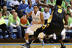 03 December 2014: North Carolina's Marcus Paige (5) and Iowa's Gabriel Olaseni (ENG) (0). The University of North Carolina Tar Heels played the University of Iowa Hawkeyes in an NCAA Division I Men's basketball game at the Dean E. Smith Center in Chapel Hill, North Carolina. Iowa won the game 60-55.