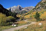 Hiking trail leading to Maroon Lake and the Maroon Bells, near Aspen, Colorado John offers fall foliage photo tours throughout Colorado. .  John leads hiking and photo tours throughout Colorado.