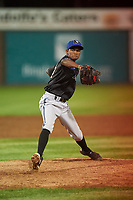 Missoula Osprey relief pitcher Oliver Rosario (17) delivers a pitch during a Pioneer League game against the Idaho Falls Chukars at Melaleuca Field on August 20, 2019 in Idaho Falls, Idaho. Idaho Falls defeated Missoula 6-3. (Zachary Lucy/Four Seam Images)
