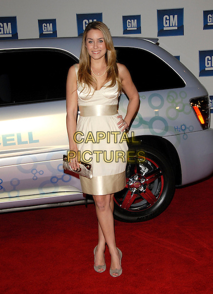 LAUREN CONRAD.The 6th Annual GM Ten Fashion Show & Concert held at Paramount Studios in Hollywood, California, USA. - Arrivals.February 20th, 2007.full length cream gold dress satin trim purse clutch dress hand on hip.CAP/DVS.©Debbie VanStory/Capital Pictures