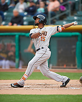 Teoscar Hernandez (15) of the Fresno Grizzlies follows through on his swing against the Salt Lake Bees during the Pacific Coast League game at Smith's Ballpark on April 17, 2017 in Salt Lake City, Utah. The Bees defeated the Grizzlies 6-2. (Stephen Smith/Four Seam Images)