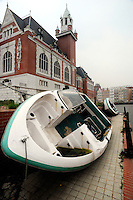 Abandoned boats in Holland Village, a 600 acre re-creation of a Dutch city on the outskirts of Shenyang lies in ruins as a monument to corruption in China. Yang, a Dutch passport, got hooked on Holland while studying horticulture at Leiden University. Yang, who built the village with some of ill gotten millions, now languishes in jail and the town that is composed of several monumental buildings, plus windmills, artificial lakes, canals, a fullsize sailing ship, 1400 luxury apartments and even an indoor beach.