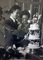 BNPS.co.uk (01202) 558833. <br /> Pic: BrendanRodgers/BNPS<br /> <br /> Sgt Edward Rodgers with his wife Mary on their wedding day after the war in July 1945. <br />  <br /> An extraordinary photograph of two RAF airmen enjoying champagne and caviar with the charismatic German officer who had just captured them has been uncovered.<br /> <br /> The image shows the downed British servicemen with Panzer commander Hans von Luck.<br /> <br /> The German made a witty point of telling any captured Allied servicemen who fell into his hands that they were in luck as he was known to be a kindly officer who treated PoWs well.<br /> <br /> His hospitality seemed to even extend to rewarding the enemy with the luxuries of Nazi-occupied France.<br /> <br /> The remarkable colourised photograph has now been published in the British magazine Iron Cross.