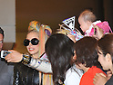 "May 8, 2012, Narita, Japan - Lady Gaga, sporting a leather coat and her rainbow-colored hair, is greeted by Japanese fans upon her arrival at Narita Airport, east of Tokyo, on Tuesday, May 8, 2012. ..The American pop singer and song writer was in Japan on a ""Lady Gaga/The Born This Way Ball"" world tour. It was her sixth visit to Japan where a teacup and saucer, marked with her lipstick and bearing the Japanese message We pray for Japan along with the stars autograph, has fetched more than $75,000 at auction.(Photo by Natsuki Sakai/AFLO) AYF -mis-.."