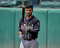 Carlos Asuaje (2) of the El Paso Chihuahuas warms up before the game against the Salt Lake Bees in Pacific Coast League action at Smith's Ballpark on April 30, 2017 in Salt Lake City, Utah. El Paso defeated Salt Lake 3-0. This was Game 1 of a double-header. (Stephen Smith/Four Seam Images)