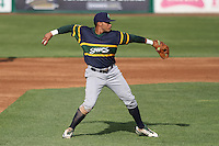 Beloit Snappers infielder Jose Brizuela (8) throws to first base during a Midwest League game against the Wisconsin Timber Rattlers on May 30th, 2015 at Fox Cities Stadium in Appleton, Wisconsin. Wisconsin defeated Beloit 5-3 in the completion of a game originally started on May 29th before being suspended by rain with the score tied 3-3 in the sixth inning. (Brad Krause/Four Seam Images)