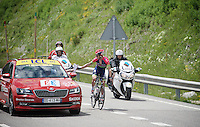 Stage leader Rui Costa (POR/Lampre-Merida) receives some 'documents' from the race officials before descending from the highest point in the 2016 Tour; the Port d'Envalira (Cat1/2408m/22.6km at 5.5%) to protect him from the cold ahead (as his teamcar wasn't able to pass the peloton coming up to provide protective clothing)<br /> <br /> stage 10: Escaldes-Engordany (AND) - Revel (FR)<br /> 103rd Tour de France 2016