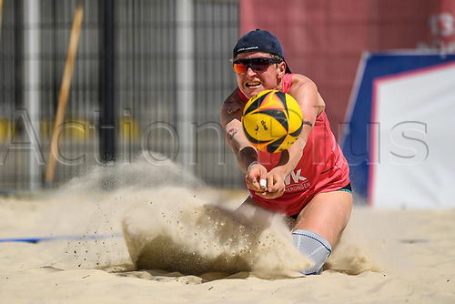 27th June 2020, Dusseldorf, Germany; The German Beach Volleyball League;  Melanie Gernert digs low to her oartner