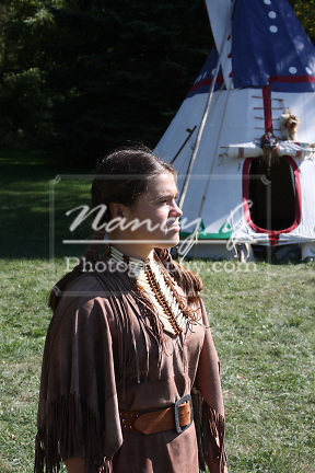 Native American Indian woman and tipi