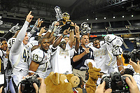 26 December 2010:  FIU Head Coach Mario Cristobal and players accept the Bowl Championship trophy after the FIU Golden Panthers defeated the University of Toledo Rockets, 34-32, to win the 2010 Little Caesars Pizza Bowl at Ford Field in Detroit, Michigan.