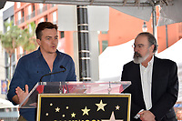 Rupert Friend &amp; Mandy Patinkin at the Hollywood Walk of Fame Star Ceremony honoring actor Mandy Patinkin on Hollywood Boulevard, Los Angeles, USA 12 Feb. 2018<br /> Picture: Paul Smith/Featureflash/SilverHub 0208 004 5359 sales@silverhubmedia.com