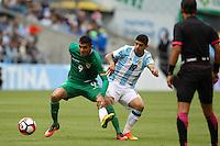 Seattle, WA - Tuesday June 14, 2016: Yasmani Duk, Ever Banega during a Copa America Centenario Group D match between Argentina (ARG) and Bolivia (BOL) at CenturyLink Field.