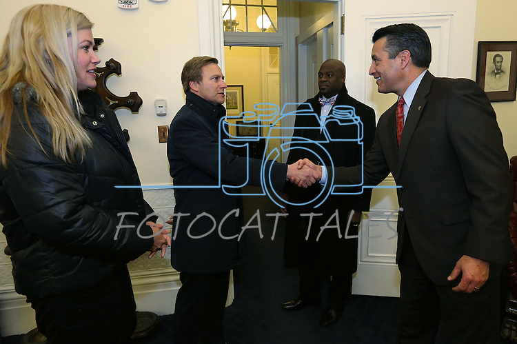 Nevada Sens. Patricia Farley, Greg Brower and Kelvin Atkinson talk with Gov. Brian Sandoval at the Capitol in Carson City, Nev., on Wednesday, Dec. 16, 2015. Sandoval called lawmakers into a special session to consider a package of tax incentives to bring the startup electric car manufacturer Faraday Future to Southern Nevada.<br /> Photo by Cathleen Allison