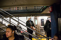 "NEW YORK, NEW YORK - MARCH 5: A woman wears a face mask while waiting for a subway at 14 St-Union Sq on March 5, 2020. in New York City. New York State has 44 people in quarantine, some 4,000 people are in ""precautionary"" quarantine in more than two dozen counties, including more than 2,700 in the city and 1,000 in Westchester, Cuomo said. (Photo by Pablo Monsalve / VIEWpress via Getty Images)"