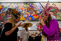 LOUISVILLE, KY - MAY 05: Two women drink their Oaks Lilies on Kentucky Oaks Day at Churchill Downs on May 5, 2017 in Louisville, Kentucky. (Photo by Scott Serio/Eclipse Sportswire/Getty Images)
