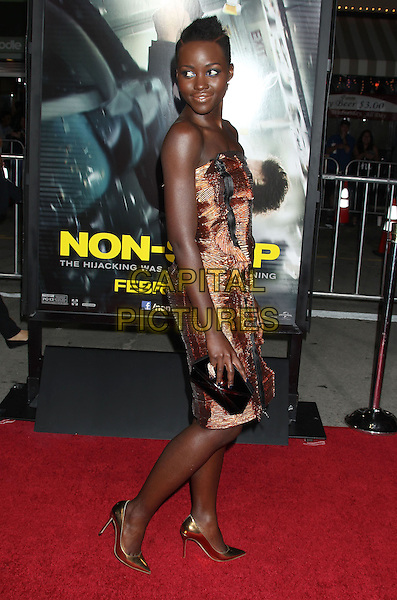 24 February 2014 - Westwood, California - Lupita Nyong'o. &quot;Non-Stop&quot; Los Angeles Premiere held at the Regency Village Theatre. <br /> CAP/ADM/RE<br /> &copy;Russ Elliot/AdMedia/Capital Pictures