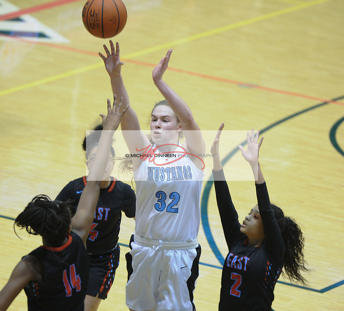 0564<br /> <br /> Chugiak&rsquo;s Ashlyn Burgess goes to the hoop surrounded by East defenders in their quarterfinal state tournament action Thursday, March 23,  2017.  Photo for the Star by Michael Dinneen