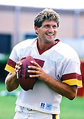Washington Redskins quarterback Joe Theismann (7) participates in a team workout at Redskins Park in Herndon, Virginia on September 4, 1985.<br /> Credit: Arnie Sachs / CNP