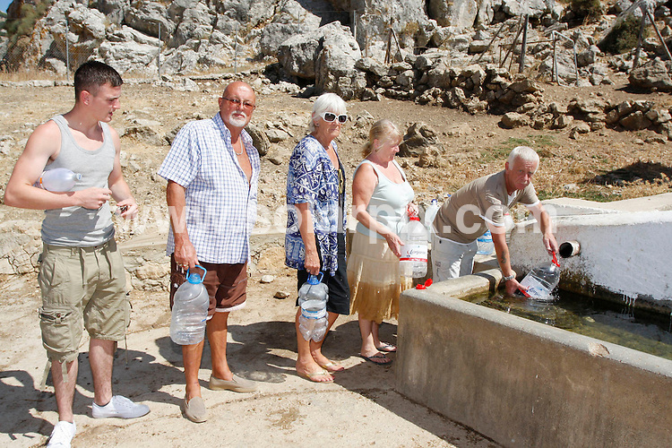 **ALL ROUND EXCLUSIVE PICTURES FROM SOLARPIX.COM**.**WORLDWIDE SYNDICATION RIGHTS**.British families are left stranded in the summer heat   without electricity and water The Villa Alta static caravan park in Spain.Site owner raised the prices by over 200 % and when they refused to pay the increase he cut them all  off...This pic: Caravan park families queuing for water at a local well which they share with goats...JOB REF: 9808        AB1       DATE:27.08.09.**MUST CREDIT SOLARPIX.COM OR DOUBLE FEE WILL BE CHARGED**.**MUST AGREE FEE BEFORE ONLINE USAGE**.**CALL US ON: +34 952 811 768 or LOW RATE FROM UK 0844 617 7637**