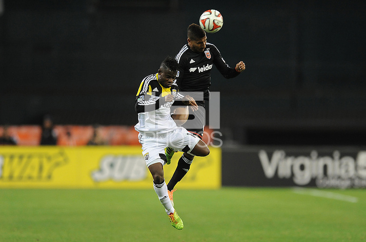 Washington D.C. - March 8, 2014: Sean Franklin (5) of D.C. United heads the ball against Waylon Francis (14) of the Columbus Crew. The Columbus Crew defeated D.C. United 3-0 during the opening game of the 2014 season at RFK Stadium.