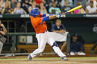 Florida Gators catcher Mike Rivera (4) swings the bat against the Virginia Cavaliers in Game 13 of the NCAA College World Series on June 20, 2015 at TD Ameritrade Park in Omaha, Nebraska. The Cavaliers beat the Gators 5-4. (Andrew Woolley/Four Seam Images)