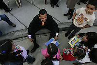 Los Angeles Mayor Antonio Villaraigosa,top, visits with schoolchildren from neighborhood schools before opening celebration at new Harbor City/Harbor Gateway Branch Library at 24000 S. Western Ave. Thursday, February 1, 2007. Construction of the new library was funded by savings from other construction projects. Money came from Proposition DD, the 1998 LA library bond that had already built 32 branch libraries, as well as funds from Proposition 14, the State Library Bond Act of 2000.