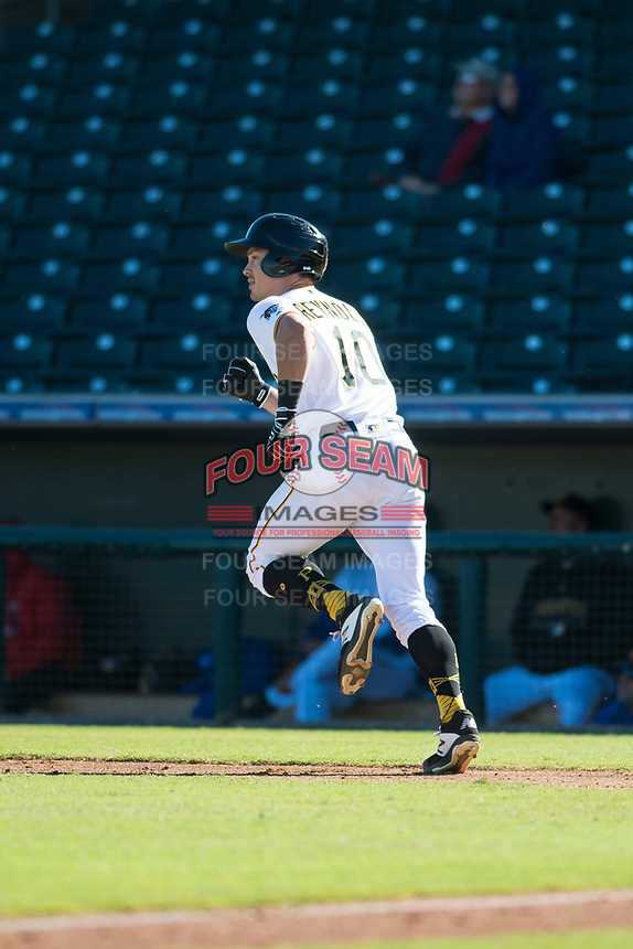 Surprise Saguaros left fielder Bryan Reynolds (10), of the Pittsburgh Pirates organization, starts down the first base line during an Arizona Fall League game against the Glendale Desert Dogs at Surprise Stadium on November 13, 2018 in Surprise, Arizona. Surprise defeated Glendale 9-2. (Zachary Lucy/Four Seam Images)