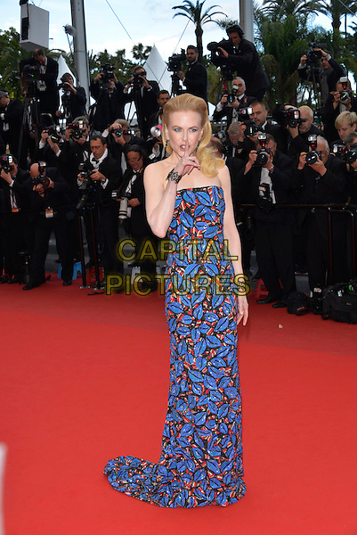 Nicole Kidman.'Inside Llewyn Davis' film premiere at the 66th  Cannes Film Festival, France 19th May 2013.full length blue strapless dress red leaf leaves pattern print hand arm finger quiet secret .CAP/PL.©Phil Loftus/Capital Pictures.
