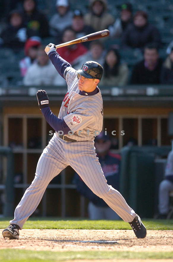 JUSTIN MORNEAU, of the Minnesota Twins, in action against the Chicago White Sox on April 8, 2007 in Chicago, IL...Twins win 3-1..CHRIS BERNACCHI/ SPORTPICS..