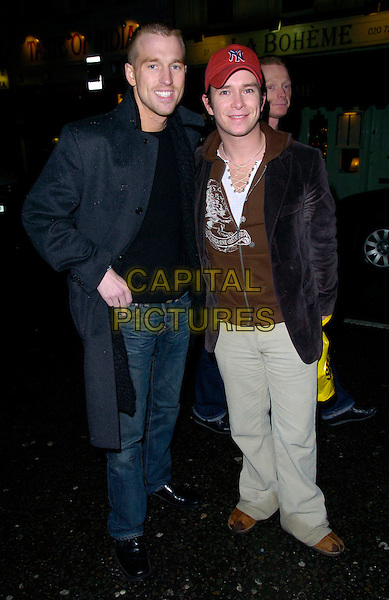 "STEPHEN GATLEY (R) & PARTNER.At the ""Sweet Charity"" Gala Performance, Theatre Royal Drury Lane, London, England, December 10th 2006..full length gately red cap hat couple.CAP/CAN.©Can Nguyen/Capital Pictures"