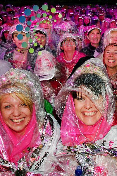 Participants smile through the rain at the start of the Edinburgh Moon Walk at Inverleith Park, Edinburgh, 9th June 2012.Picture:Scott Taylor Universal News And Sport (Europe) .All pictures must be credited to www.universalnewsandsport.com. (Office)0844 884 51 22.