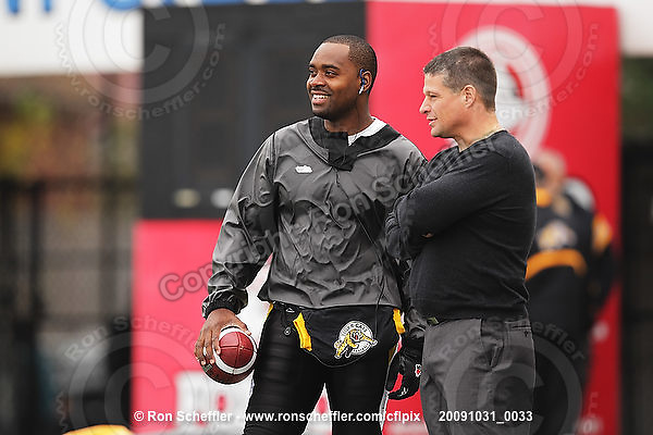 October 31, 2009; Hamilton, ON, CAN;  Hamilton Tiger-Cats quarterback Kevin Glenn (5) and head coach Marcel Bellefeuille chat prior to the game. CFL football: Saskatchewan Roughriders vs. Hamilton Tiger-Cats at Ivor Wynne Stadium. The Tiger-Cats defeated the Roughriders 24-6. Mandatory Credit: Ron Scheffler. Copyright (c) 2009 Ron Scheffler.