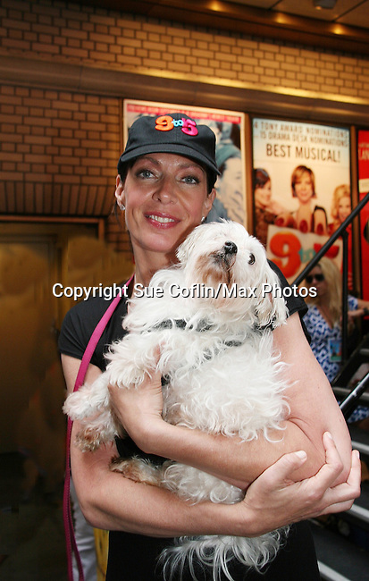 """Guiding Light's Allison Janney at Broadway Barks 11 - a """"Pawpular"""" star-studded dog and cat adopt-a-thon on July 11, 2009 in Shubert Alley, New York City, NY. (Photo by Sue Coflin/Max Photos)"""