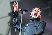 18th July 2014: British alternative rock band Editors play the Obelisk Arena on the second day of the 9th edition of the Latitude Festival, Henham Park, Suffolk. <br /> Tom Smith (lead vocals, guitar, piano)<br /> Russell Leetch (bass guitar, synthesizer, backing vocals)<br /> Ed Lay (drums, percussion, backing vocals)<br /> Justin Lockey (Lead guitar)<br /> Elliott Williams (Keys, synthesizers, guitars, and backing vocals) .<br /> Picture by Stuart Hogben