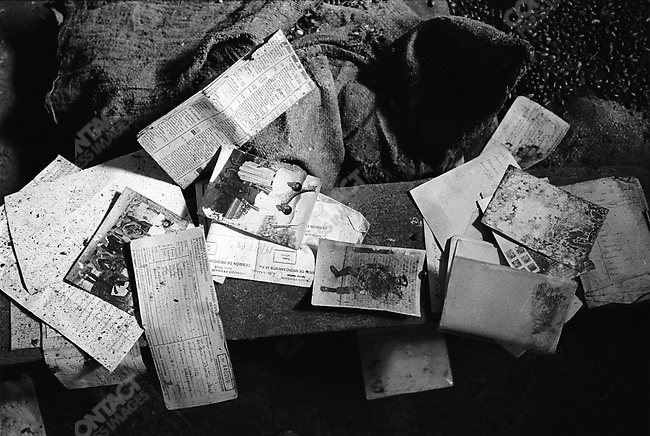 Papers belonging to the victims of the genocide are preserved on the grounds of Ntarama Church, outside Kigali, Rwanda, 2002