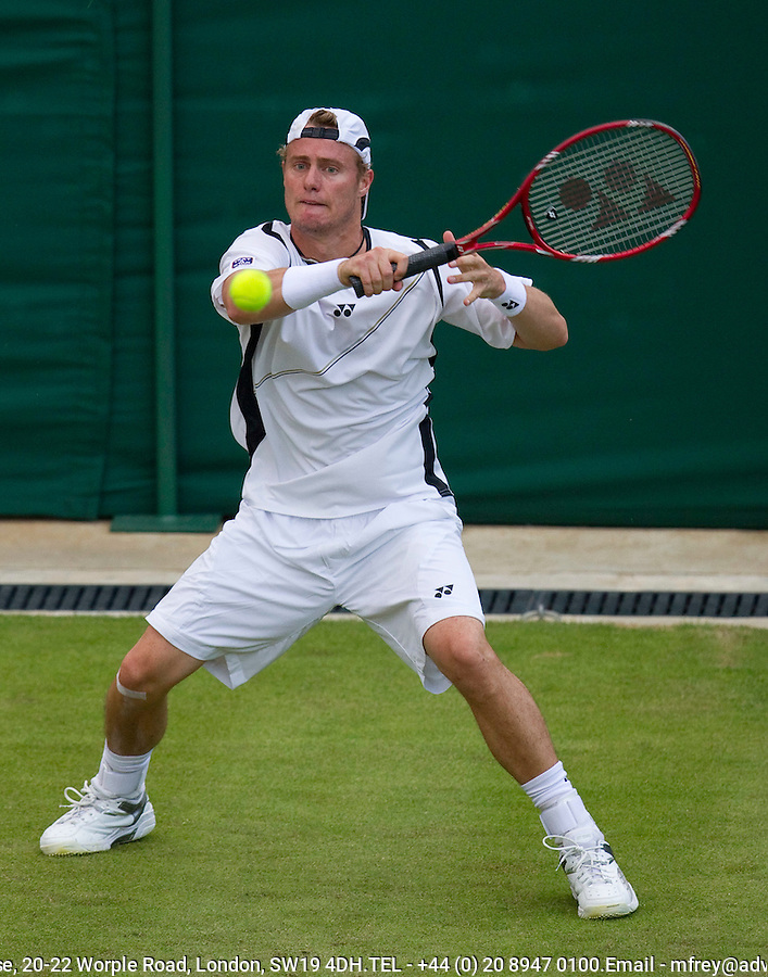 Lleyton Hewitt (AUS) (15) against Maximo Gonzalez (ARG) in the first round of the gentlemen's singles. Lleyton Hewitt beat Maximo Gonzalez 5-7 6-0 6-2 6-2..Tennis - Wimbledon Lawn Tennis Championships - Day 1 Mon 21 Jun 2010 -  All England Lawn Tennis and Croquet Club - Wimbledon - London - England..© FREY - AMN IMAGES  Level 1, Barry House, 20-22 Worple Road, London, SW19 4DH.TEL - +44 (0) 20 8947 0100.Email - mfrey@advantagemedianet.com.www.advantagemedianet.com