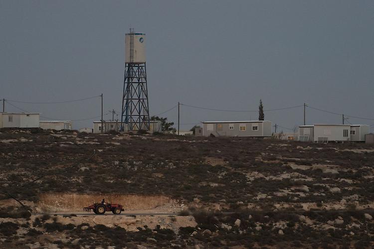 A tractor makes its way to the Israeli outpost of Keida, West Bank.